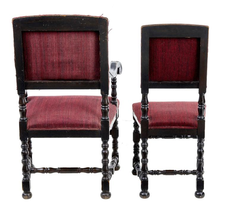 Carved Set of Ten and Two Early 20th Century Baroque Influenced Oak Dining Chairs For Sale