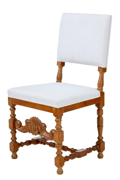 Set of ten Baroque influenced carved oak chairs, circa 1910. Good quality set of chairs with carved front rail, standing on turned legs and stretchers. Varnished into a golden oak color, would benefit from being stripped which we could undertake
