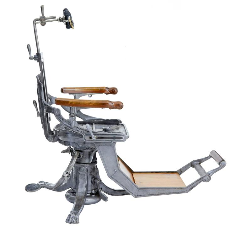 Here we present a rare American cast iron dentist chair, circa 1890. We have had this restored at great expense, walnut shell blasted and lacquered. Hydraulic movement with chair being raised by foot pedal. Very decorative top end version on this