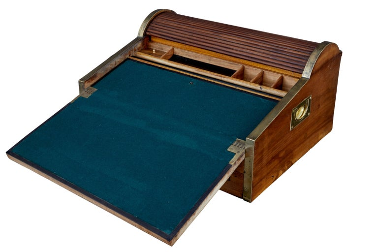 Quality Chinese export camphor wood lap desk, circa 1820. Made for sea Captains and military officers in the field. Brass bound round the outer edge with brass carrying handles. Tambour top opens when you open the front drawer to reveal storage in