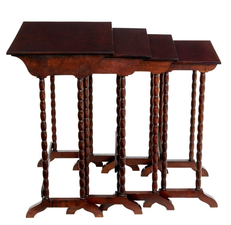 Scandinavian birch nest of four occasional tables, circa 1950.  Good quality birch which has been stained to the color of mahogany.  Bobbin turned legs.