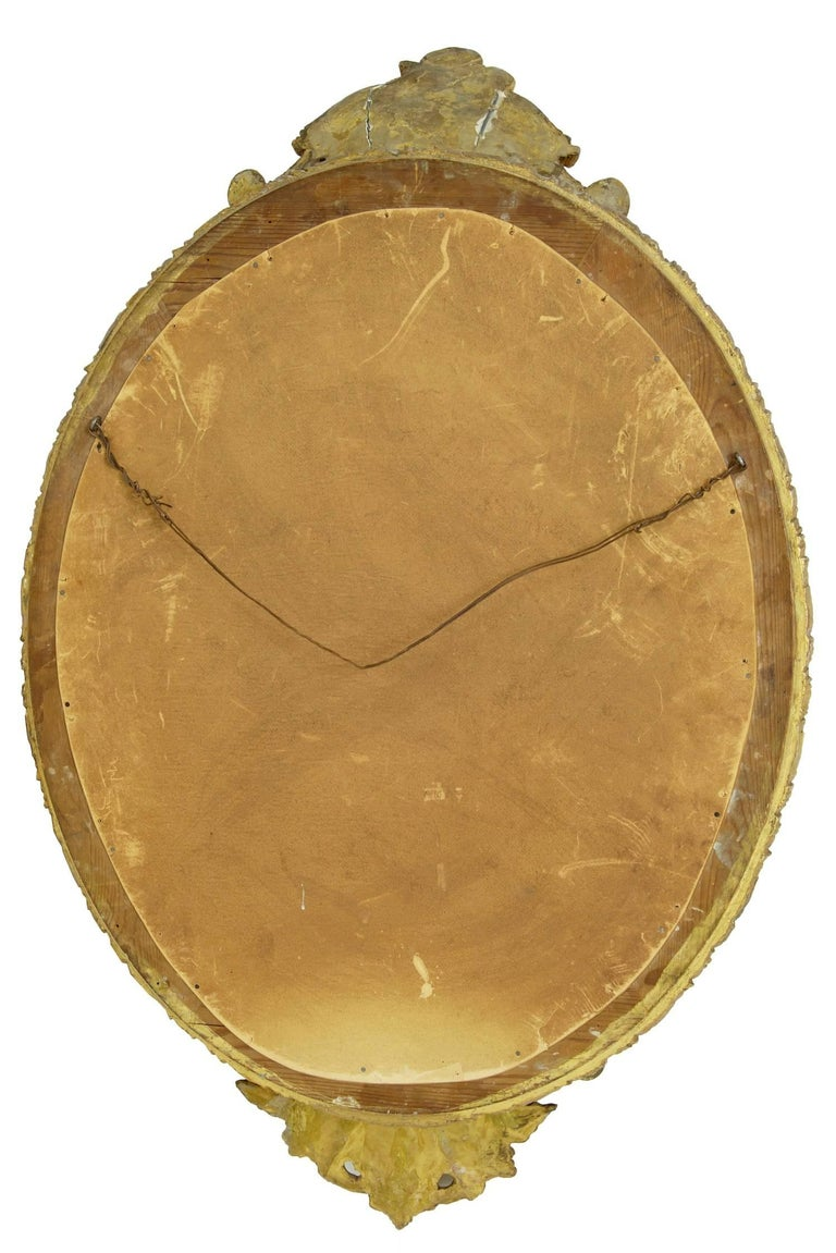 British 19th Century Carved Burnished Gilt Oval Mirror For Sale