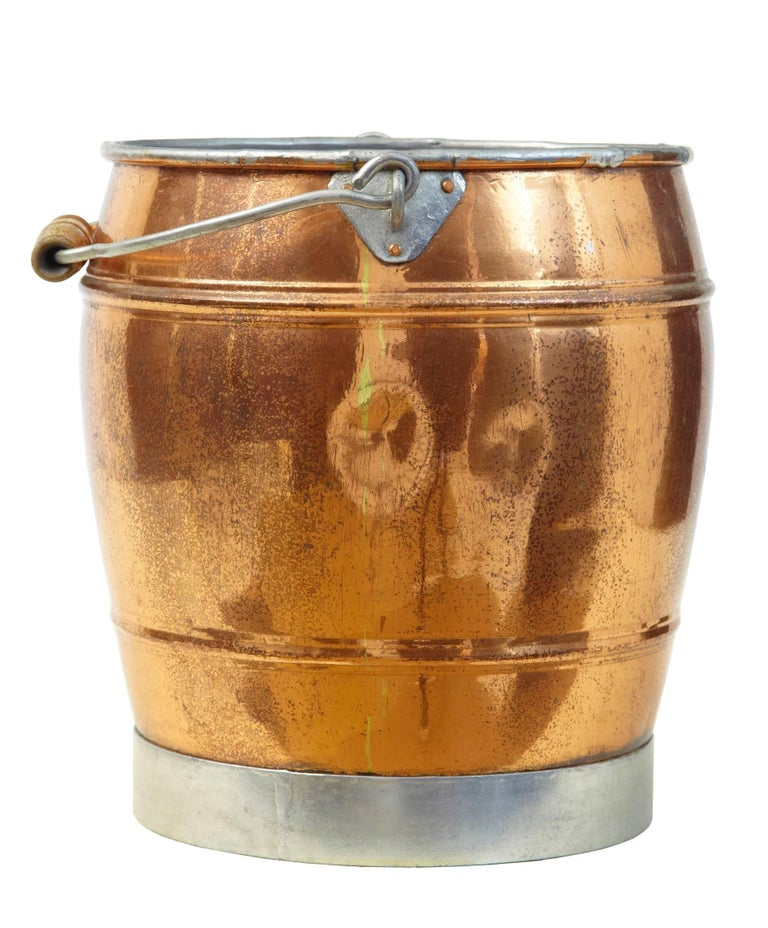 Fine keg shaped bucket, circa 1890. Steel rimmed base with wooden handle.