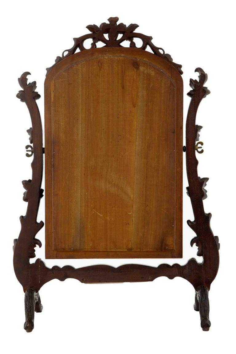 German 19th Century Carved Lindenwood Black Forest Vanity Mirror For Sale