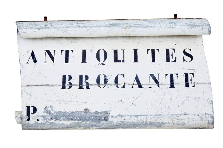 Here we present an unusual find of a French antique shop sign, circa 1920.
