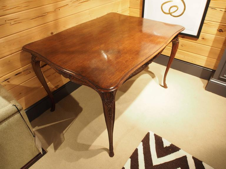 French oak table circa with ornate carved apron and