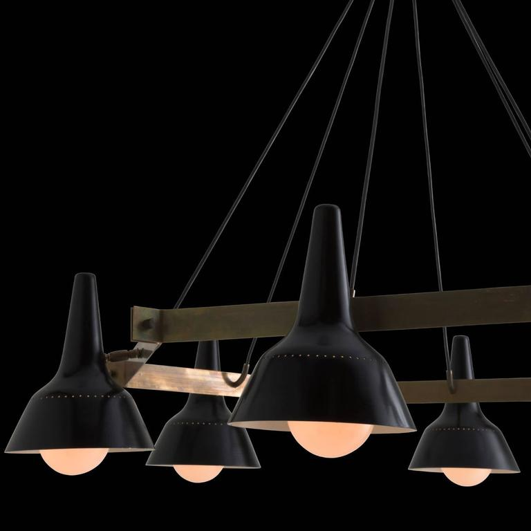 """Brass hexagon and black metal modern chandelier.  Italy, circa 1970.  Adjustable six-arm rectangular chandelier. With black metal shades.  Measures: 41"""" L x 29"""" D x 46"""" H."""