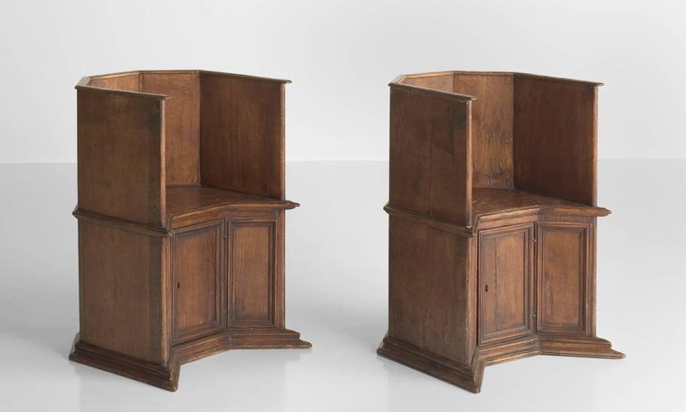 Pair of Gothic oak cathedral chairs, Italy, circa 1800.  Hand-crafted, beautiful forms with rich patina includes a door under the seat for storage.