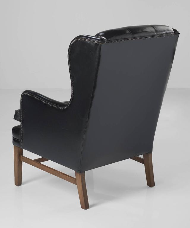 Swedish Black Leather Wing Armchairs, circa 1950 For Sale