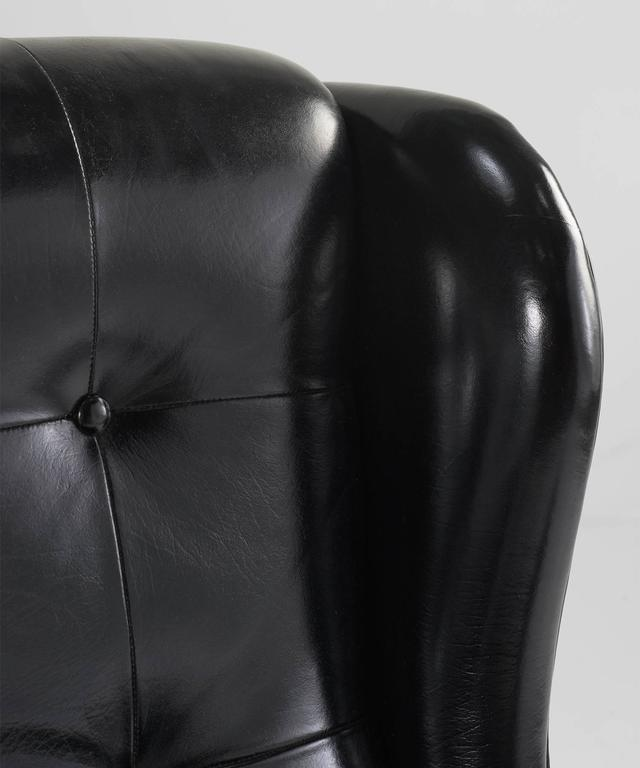 Mid-20th Century Black Leather Wing Armchairs, circa 1950 For Sale