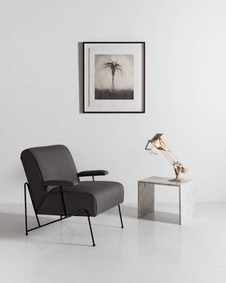 Hairpin powder coated black iron frame with upholstered chair and armrests; America, circa 1950.