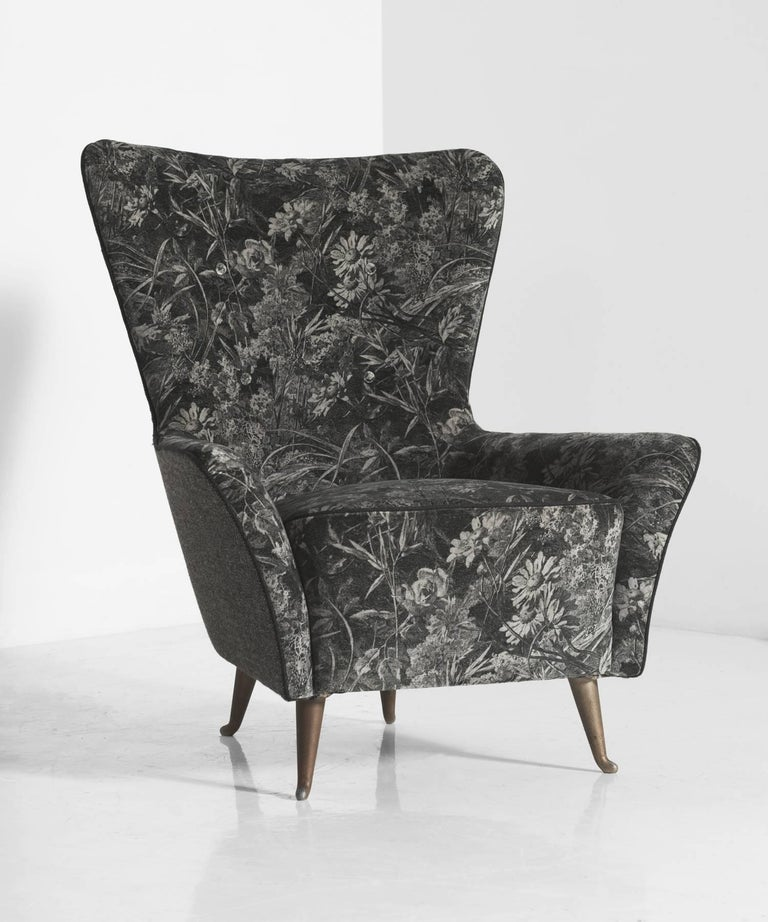 Classic Italian armchairs with striking, elegant form; reupholstered with Liberty of London Royal Daisy Velvet with contrast black wool piping and charcoal wool upholstery by Maharam on the sides and back; gilded wood feet; Italy, circa 1960.