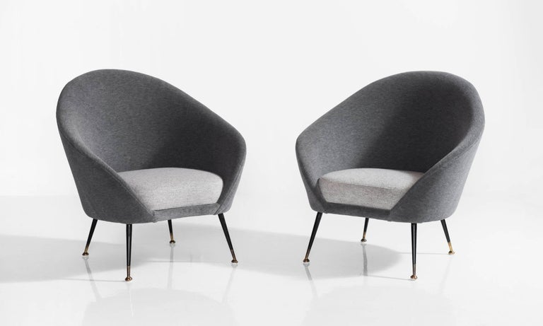 Pair of Italian open armchairs, circa 1950.