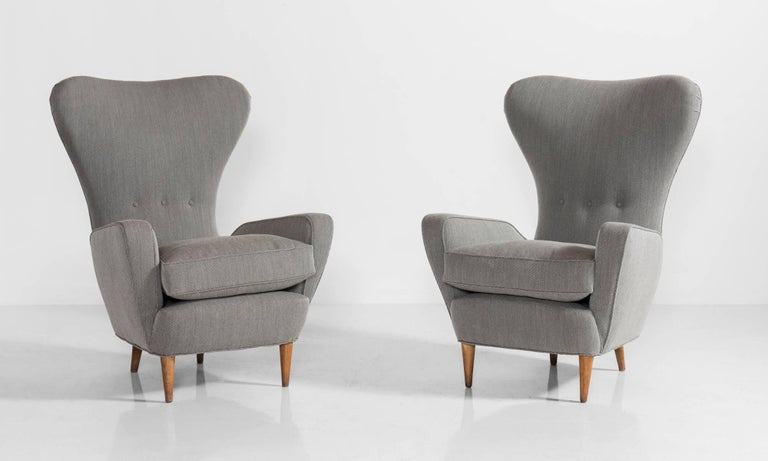 Handsome form reupholstered in wool steel cut Kvadrat fabric.