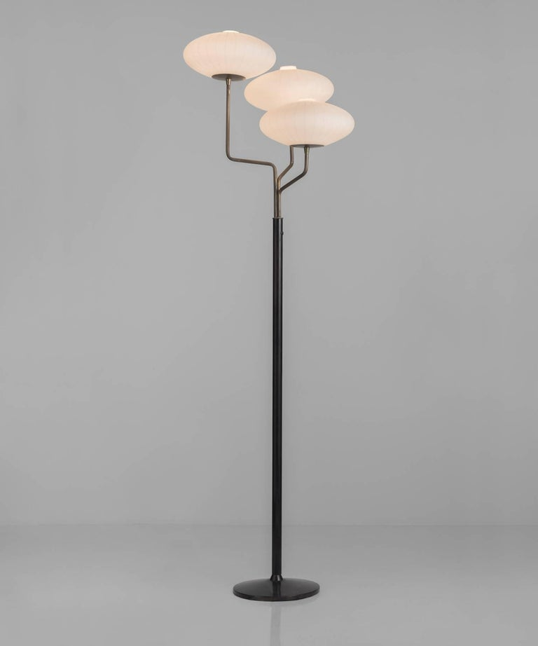 Elegant opaline shades with vertical glossed line patterning. Brass arms on metal stand.