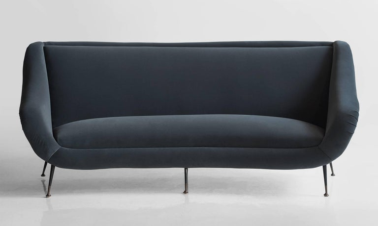 Curved form, newly reupholstered in Maharam fabric.