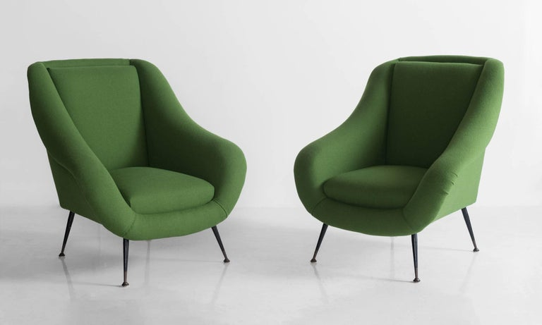 Handsome armchairs, newly reupholstered in green wool by Kvadrat.