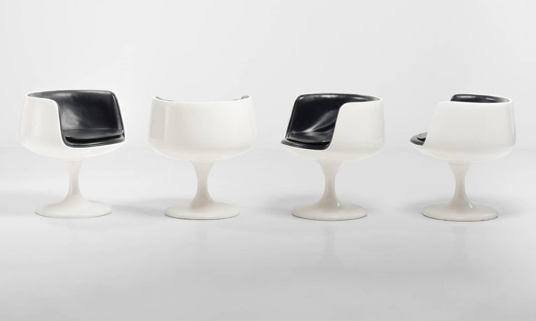 Set of (4) Eero Aarnio Style Dining Chairs, Finland, circa 1960  Swivel chairs with fiberglass base and black vinyl upholstery, in the style of Eero Aarnio.