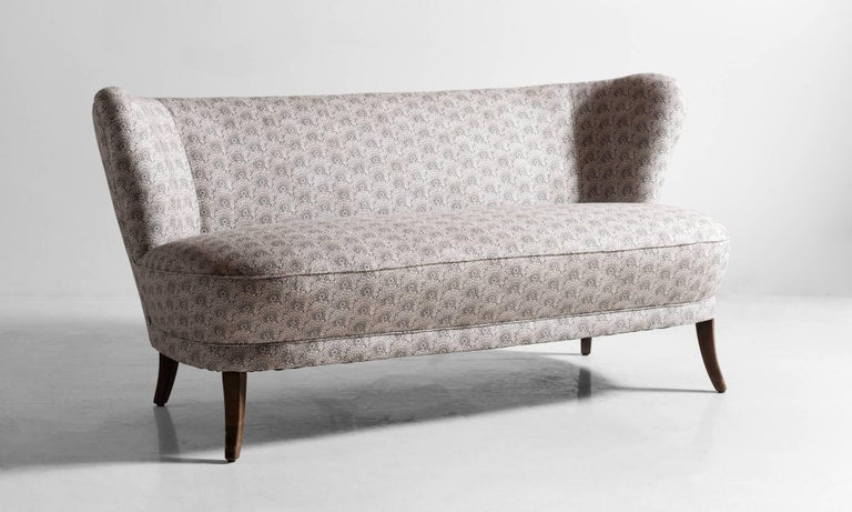 Cocktail sofa, circa 1950  Petite sized and elegant form, reupholstered in Liberty of London cotton-linen fabric.