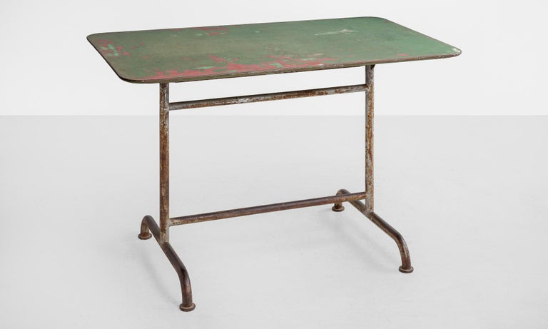 Simple form, fold down factory table in original green paint.  Made in America, circa 1920.