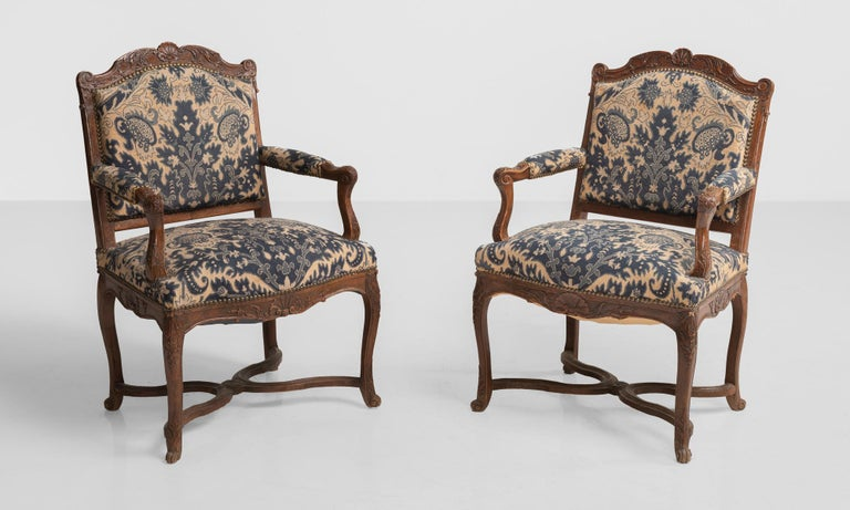 Tapestry armchairs, circa 1890.  Elegantly carved back and frame with beautiful needlework upholstery.