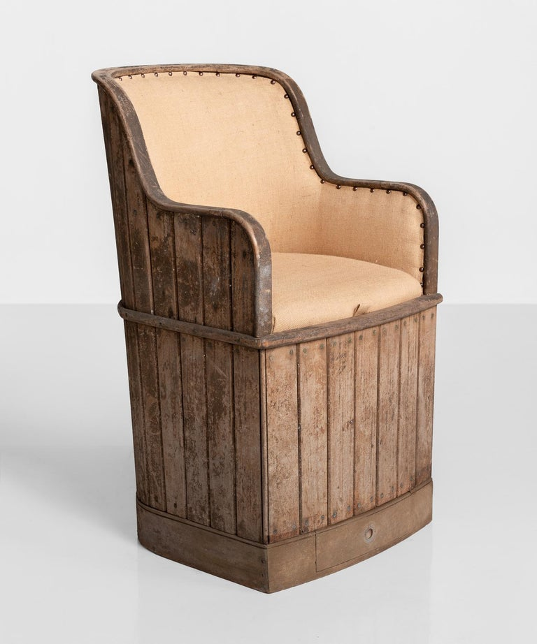 Teak ships armchair, circa 1880.  Slatted teak construction with brass screws, newly upholstered in linen. Seat lifts off to reveal a large storage area underneath.