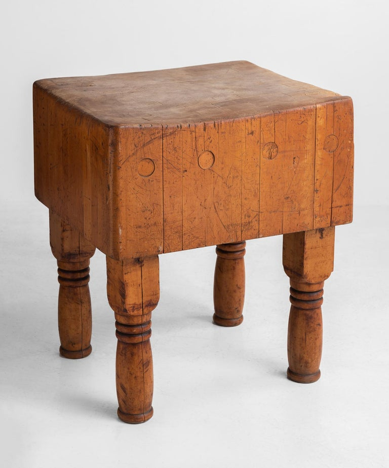 Butcher block, circa 1930.  Handsome form with heavily used slab top on turned legs.