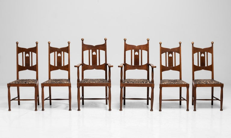 Set of 6 Arts & Crafts oak dining chairs, England, circa 1900.  Highback oak dining chairs in the manner of Liberty & Co. with upholstered seat in the style of William Morris.  Measures: 18.5