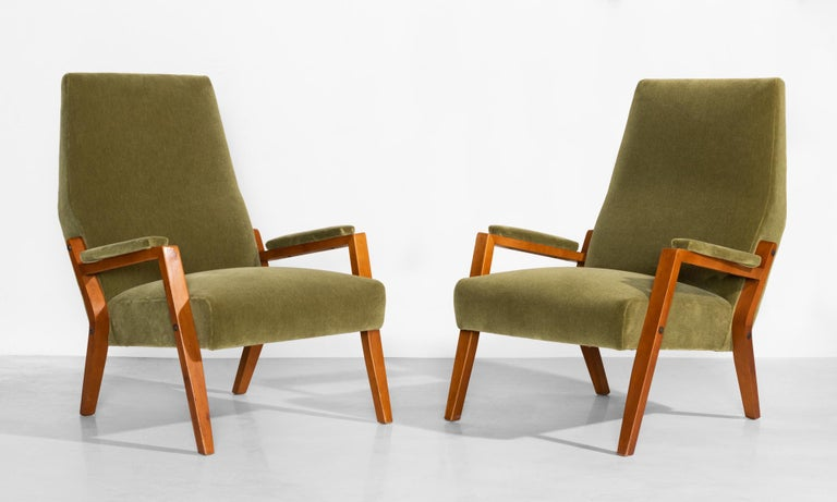 Pair of mohair lounge chairs, circa 1960  Handsome, low forms with beautiful joinery details, metal hardware and newly upholstered seats and armrests in Maharam mohair supreme.