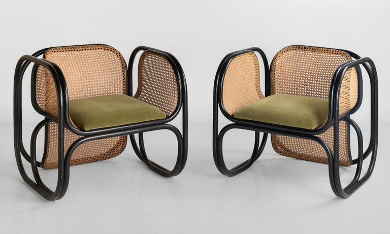 Pair of Jan Bocan armchairs, Czech Republic, circa 1970.  Produced by Thonet, designed for the Czech Embassy of Stockholm. One pair of the 60 armchairs produced. Ebonized bentwood frame with cane webbing on back and sides. Seat is upholstered in