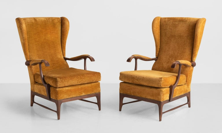 Pair of Paolo Buffa armchairs, Italy, circa 1960.  Designed by Paolo Buffa and manufactured by Framar. Carved wooden frame with original velvet upholstery fitted with brass nails.  Measures: 27