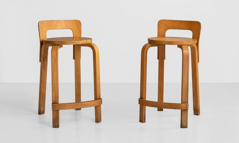 Alvar Aalto bentwood stools, Finland, circa 1950.  Model K65 teak barstools in original condition.  Measures: 13