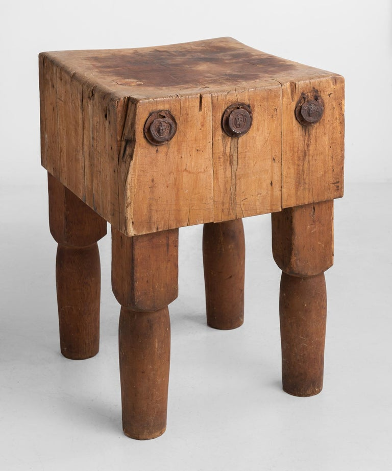 Butcher block table, America, circa 1930.  Simple form, with original patina and large metal rivets. Maple top with thick pine legs.  Measures: 20.5