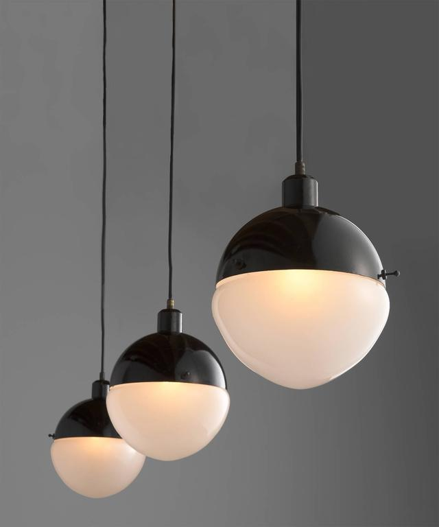 Black Metal & Frosted Glass Pendant, Italy, 21st century  Frosted glass shade in drop form with black metal fitter. Italian modern design with a four-week lead time.  Overall height adjustable.
