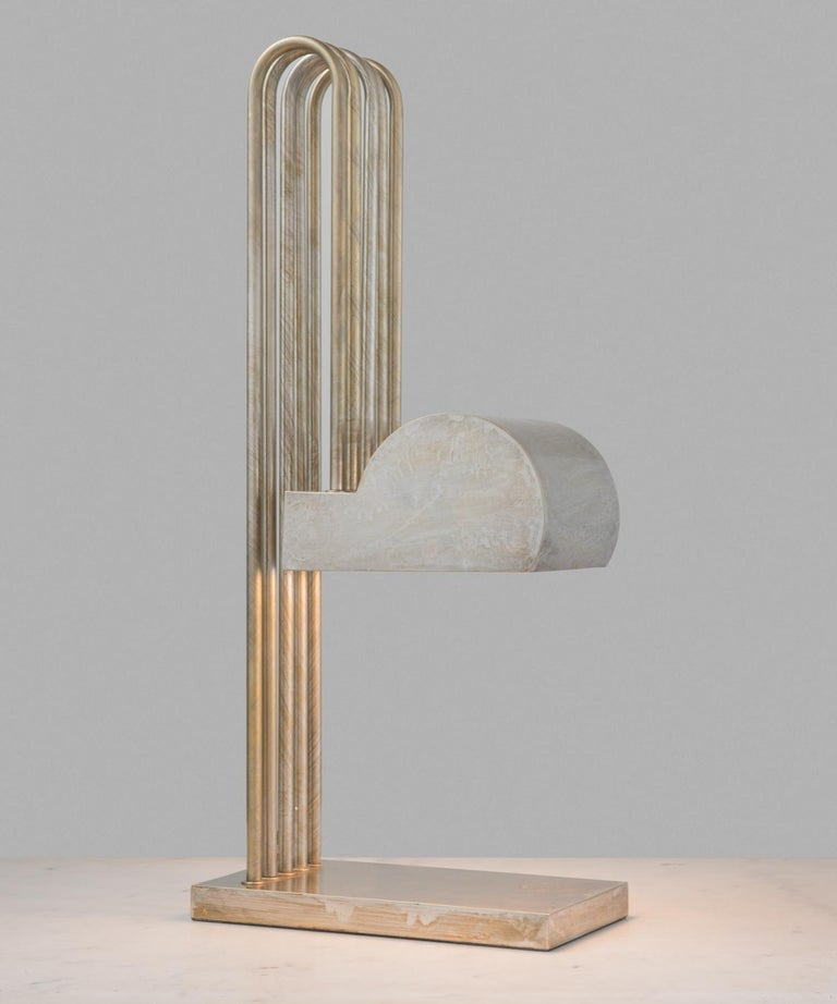Marcel Breuer desk lamp, circa 1925  Created for the International Exposition of Modern Industrial and Decorative Arts in Paris. Brass-plated nickel and stamped