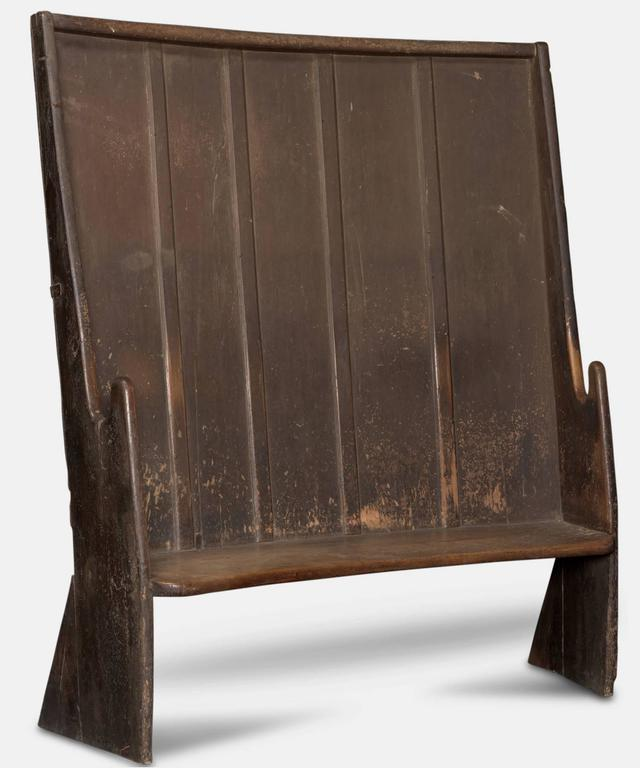 West country settle with slightly curved pine back and a thick slab fruitwood seat.
