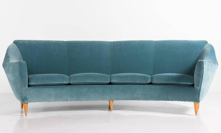 Velvet and wood curved modern sofa, circa 1960.