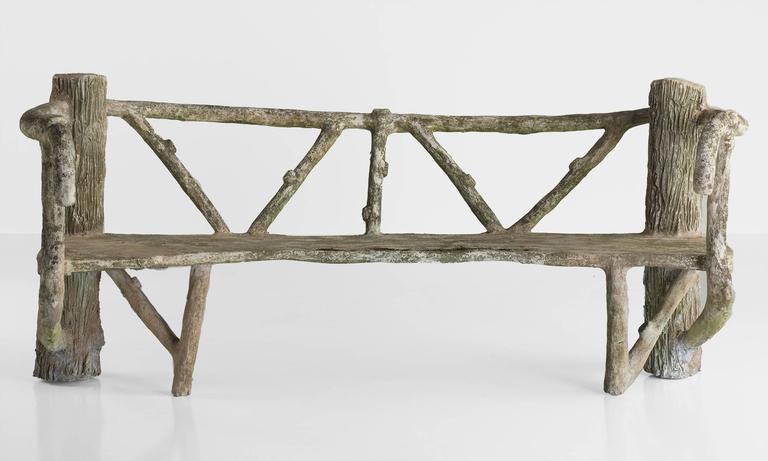 Cast stone faux bois garden bench, circa 1930.  Unique form with wonderful patina and original lichen.