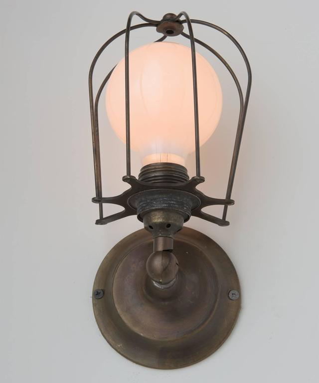 Industrial Brass Caged Wall Sconce, Italy, 21st century For Sale