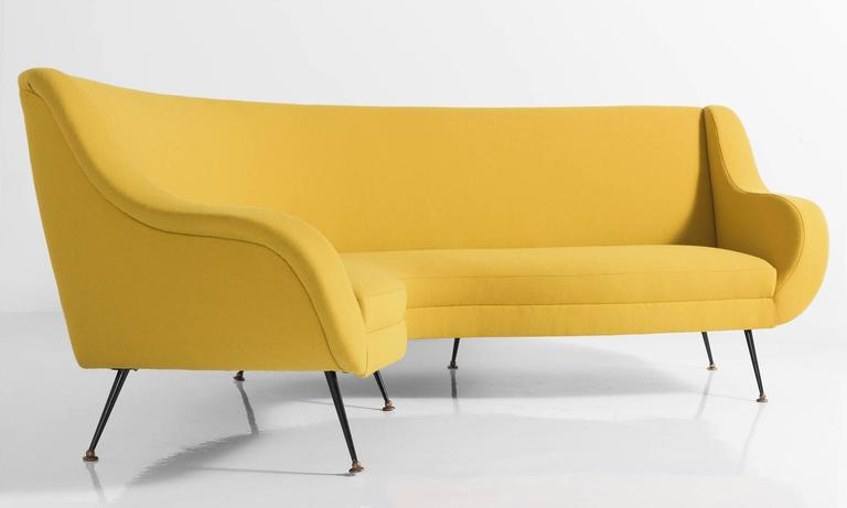 Modern conversational sofa with painted black metal feet. Newly reupholstered in yellow Maharam wool fabric. Incredible form.