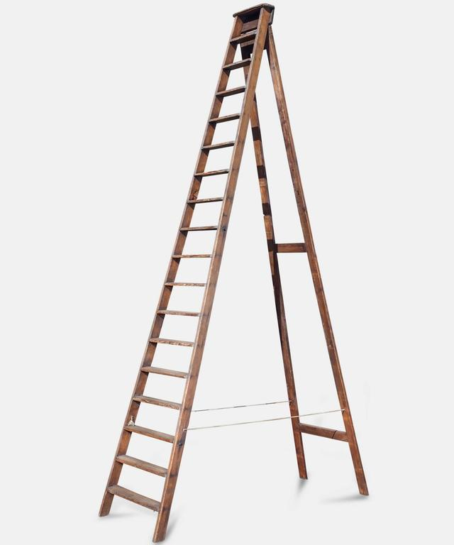 Solid wood ladder with impressive height.