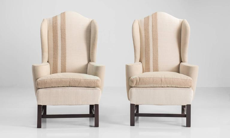 Pair Of Upholstered Wingback Chairs, Circa 1950 Classic Form Reupholstered  In Cotton With Exposed Stitching