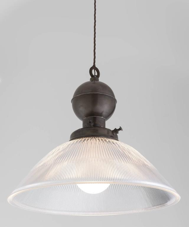 Industrial Glass and Brass Gas Lamp Pendant, Italy, 21st century  In the style of an industrial gas lamp pendant, converted to electric.