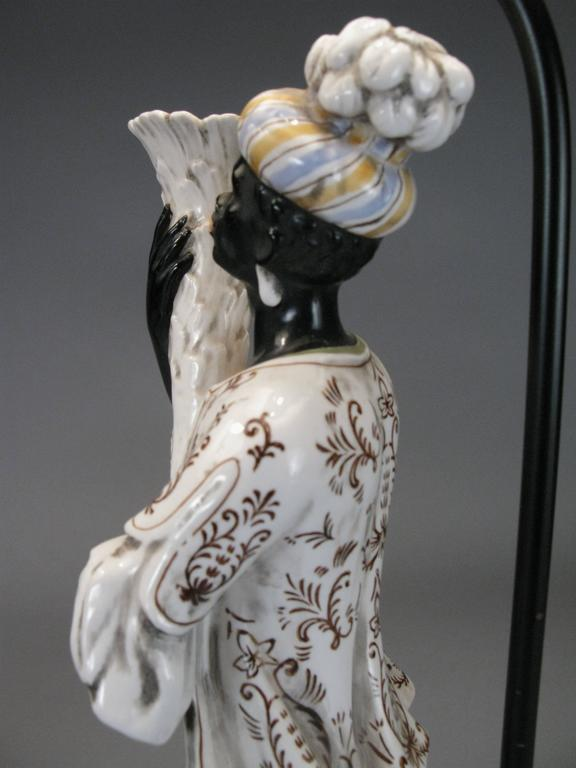 Pair Of Antique Hand Painted Porcelain Blackamoor Lamps At
