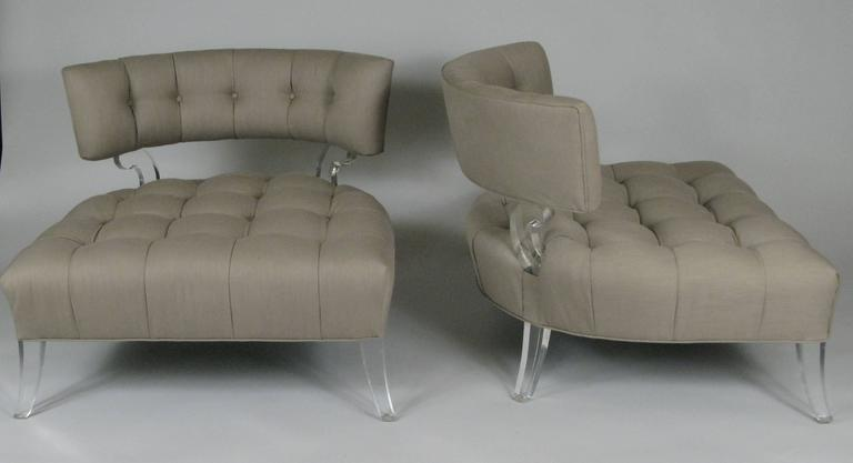 An extremely rare pair of 1940s slipper chairs with Lucite frames and deeply tufted seats and curved backs. These are one of the most iconic pieces from Lorin Jackson's 'Glassics' collection, which used the new Lucite material as an integral element