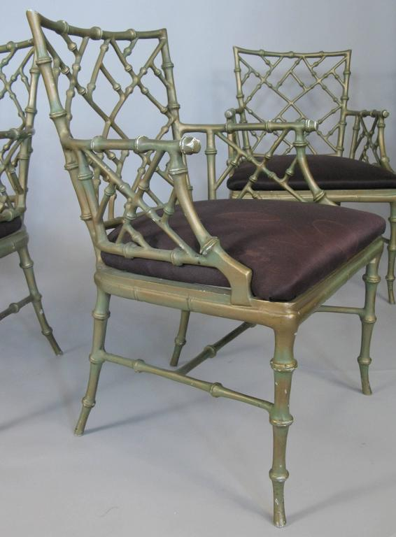 A very nice matched set of four cast metal 'bamboo' armchairs designed by Phyllis Morris. Beautiful Classic design in these very well made armchairs with wonderful details. Original gold wash finish is worn, and the upholstery will need to be