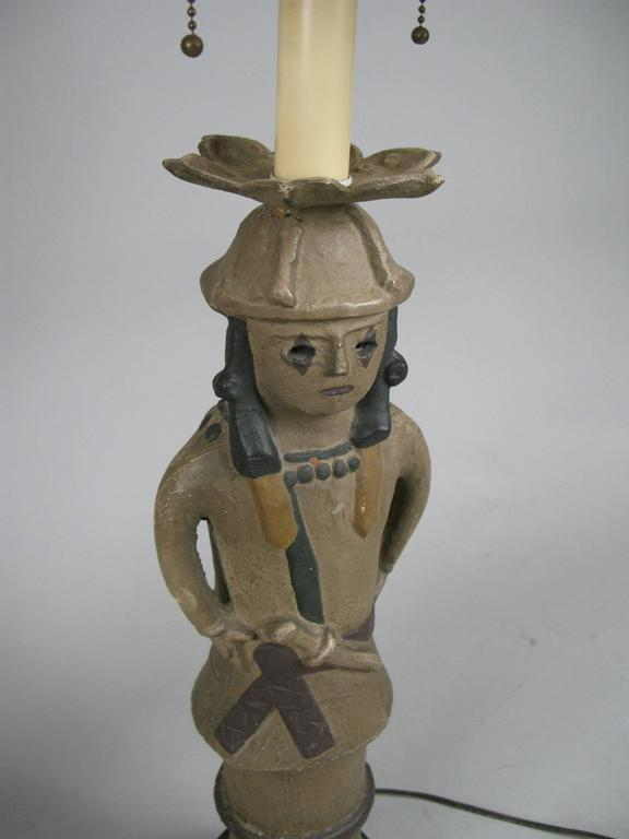 A very unusual pair of antique pottery lamps in the form of a male and female Samurai. Very well made and heavy, with beautifully painted finish, and steel bases. The fittings have a double socket each, and also a large center light. With six sided
