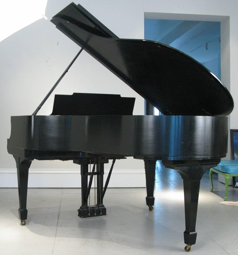 Classic 1912 Steinway & Sons model M Piano in very good condition. The interior works were likely restored in the 1950s with a fairly recent filing and reshaping of the hammers. The sound board is free of any issues, and the strings and pins are