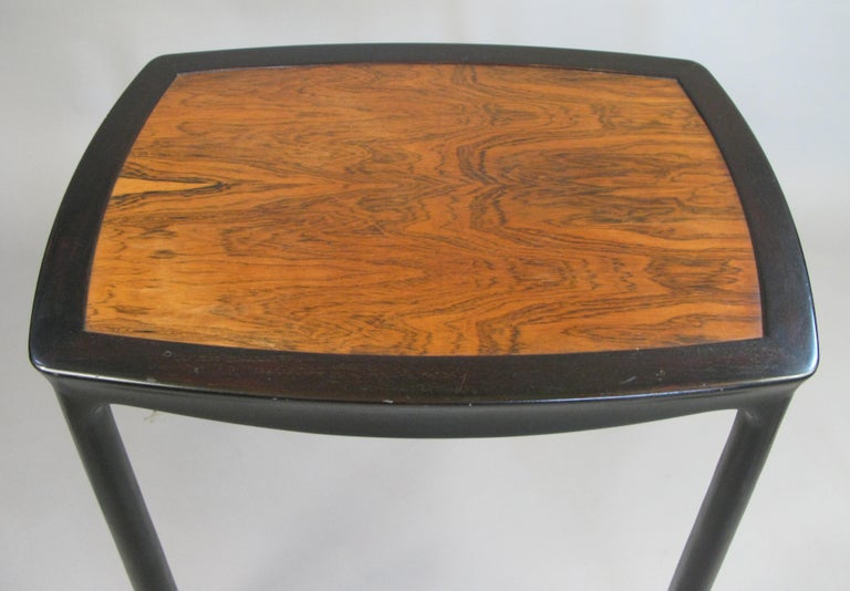 A very nice vintage 1960s occasional table by Edward Wormley for Dunbar. Beautiful details with subtly curved top and skirt, and legs which are slightly wider at the base. Frame is ebonized mahogany and the inset top is rosewood.