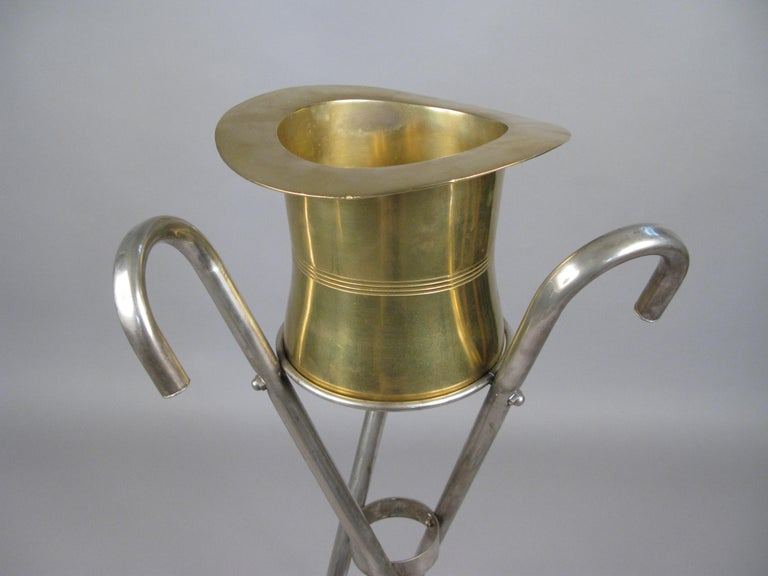 A very unique vintage 1970s silverplate top hat form champagne bucket on its stand formed with three canes.